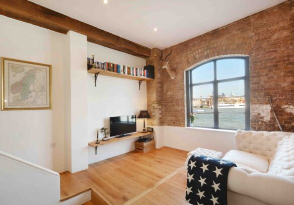 riverside-loft-rotherhithe-street-SE16-living-room-warehouse-view