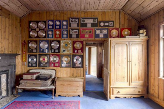wall with gold records at the limes cottage