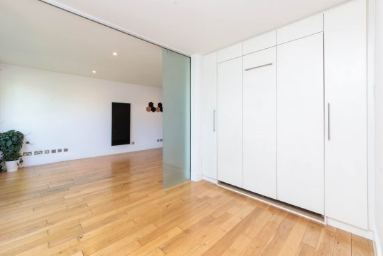contemporary-warehouse-madison-apartments-se1-kitchen-second-reception-room-pull-down-bed