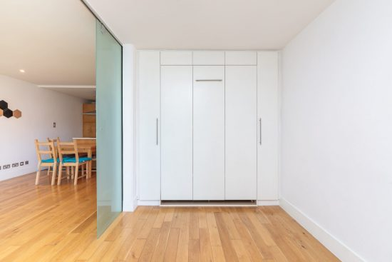 contemporary-warehouse-madison-apartments-se1-second-reception-pull-down-bed
