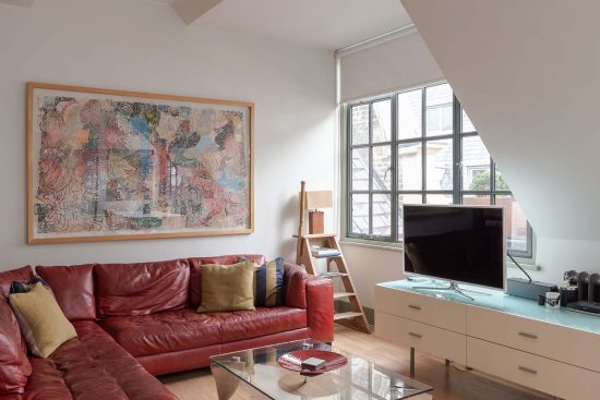 kean street wc2 living area with red sofa