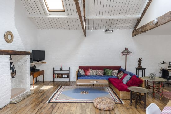 converted workshop living room with corner couch